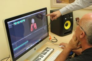 local entrepreneur learning how to edit a video in the media lab