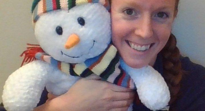 Person hugging snowman