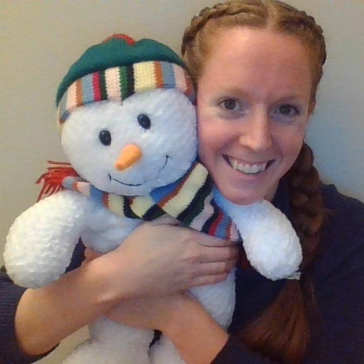 Person hugging snowman